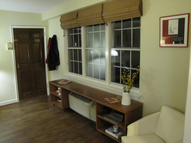 Fake Built-In Shelving Around Eyesore Wall Heater | The Borrowed Abode
