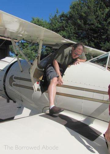 Climbing Into Biplane Cockpit