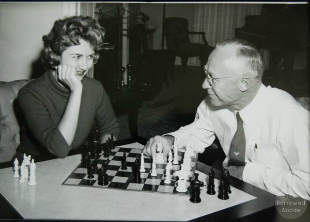 My mom and her dad, playing chess in the 60s. She is a killer strategist in games.